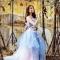 Lily Luta hóa công chúa gợi cảm với váy cưới xanh ngọc