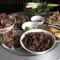 Rượu thịt chó: Bữa tiệc truyền thống trở nên tai tiếng