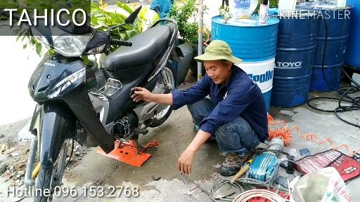 Bàn nâng rửa xe máy 1 trụ thủy lực